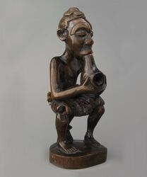 Seated pipe smoker from the Kuba