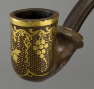 Clay pipe with gold leaf