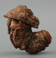 Grotesque pipe with clown heads
